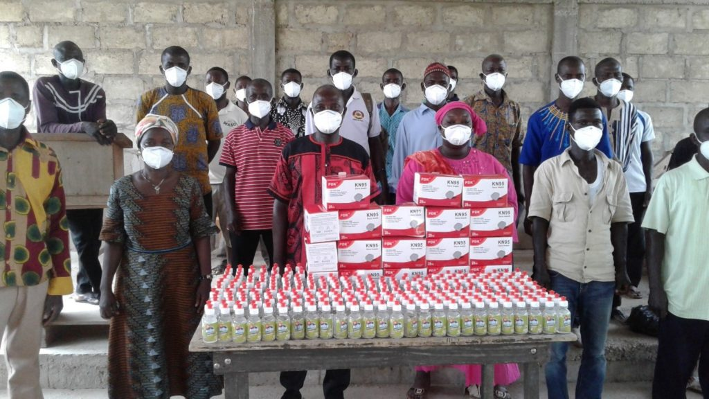 Members of the farmers' cooperative group in the donated nose mask. In display are selected number of hand sanitizers donated